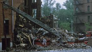 Ladder 15's 1971 Maxim ladder truck crushed in the collapse.