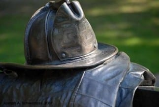Closeup of the firefighter helmet. The company number is '33'.